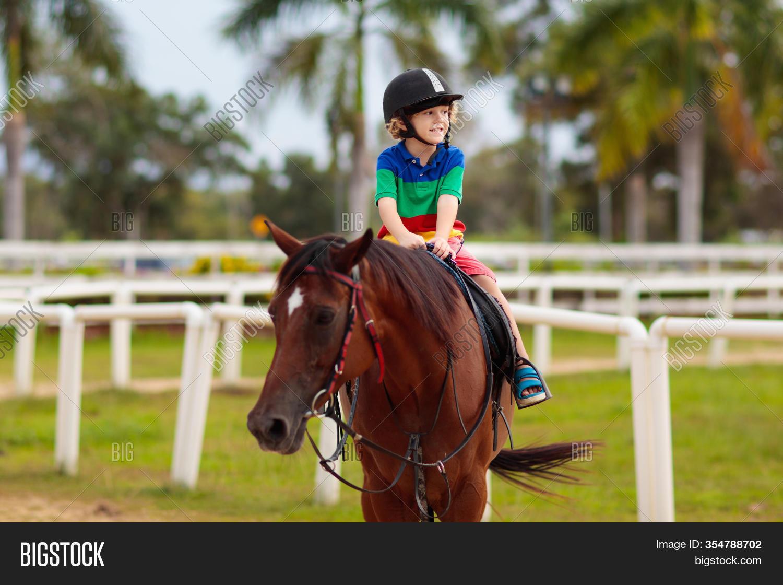 Kids Ride Horse Child Image Photo Free Trial Bigstock