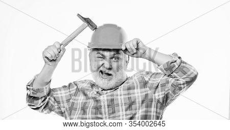 Man Bearded Laborer Wear Helmet Hold Hammer. Repair Workshop. Repair Concept. Senior Foreman Worker.