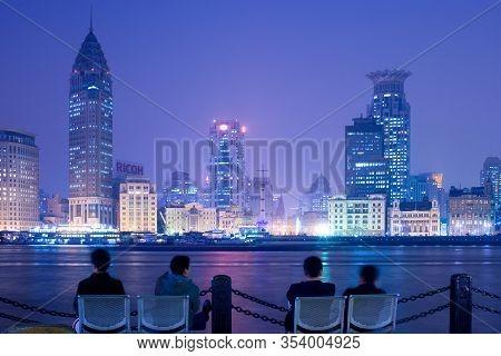Shanghai, China - November 20, 2008: People Watching The Bund Skyline Across The Huangpu River From