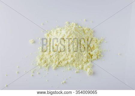 Purified Sulfur Powder On A White Acrylic Background