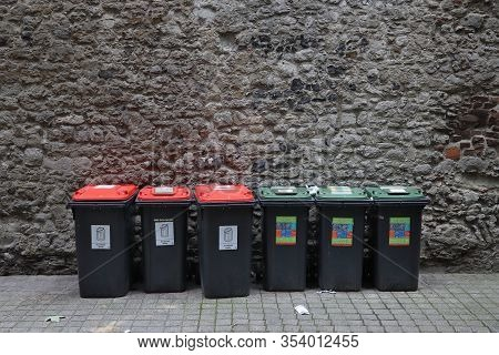 London, Uk - July 13, 2019: Mixed Household Waste And Household Recycling Sorted Garbage Bins In Lon