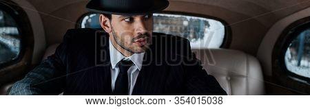 Tense Mafioso Looking Away In Retro Car, Panoramic Shot