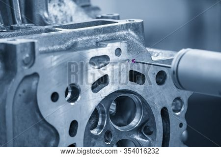 The Multi-axis,cmm Probe  Measure Dimension Of The Aluminium Casting Cylinder Head Parts .the Qualit
