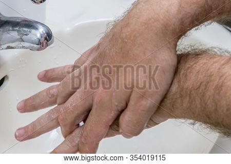 Man Washing Hands In Basin Close-up
