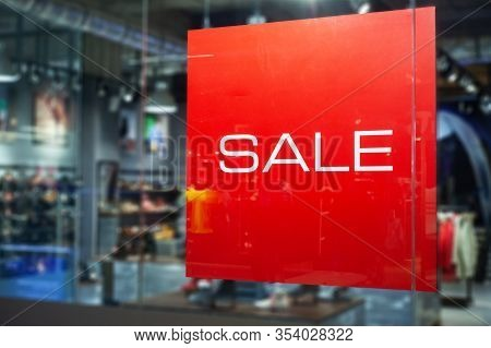 Picture Of Shop Window Display With Text Sale On Red Poster. Shopping Sale Background.
