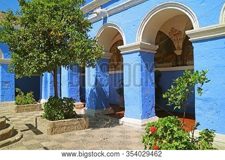 Gorgeous Cloister With Vibrant Blue Columns In Santa Catalina Monastery, Arequipa, Peru, South Ameri