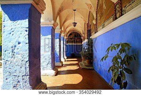 Vivid Blue Corridor Columns In The Monastery Of Santa Catalina, Historical Place In Arequipa, Peru,
