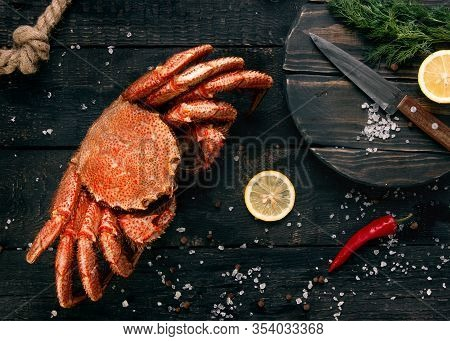Fresh Hairy Crab With Spices On A Wooden Background. Seafood. Fresh Crab Hairy Close-up.