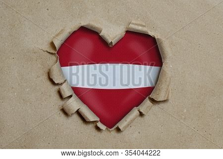 3d Illustration. Heart Shaped Hole Torn Through Paper, Showing Latvian Flag