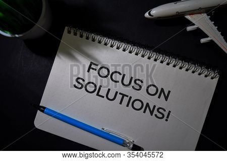 Focus On Solutions! Write On A Book Isolated On Office Desk.