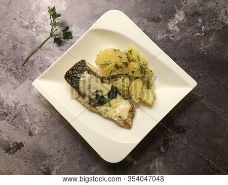 Grilled Salmon Fillet With Garlic Sauce And Parsley Potatoes. Diet And Healthy Eating Concept.
