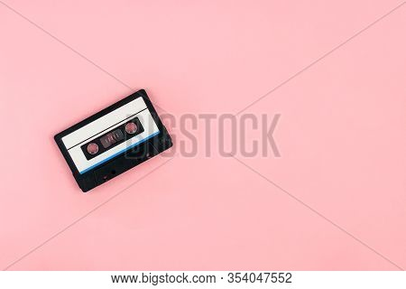 Retro Audio Cassette Tape Flat Lay On Colorful Pink Background Top View With Copy Space. Creative Fa