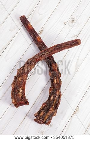 Dried Oxtails On White Wooden Background. Could Be Used In Exotic Cuisine Or As Natural Chew Treats
