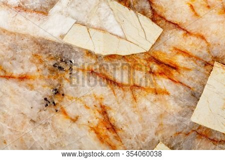 Brown Cracks In The Heterogeneous Structure And Surface Texture Of Beige Marble, Close-up, Top View.