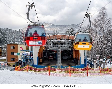 Ruzomberok, Slovakia - February 28: Cabins Of Cableway And Skiers On Slope At Resort Malino Brdo On