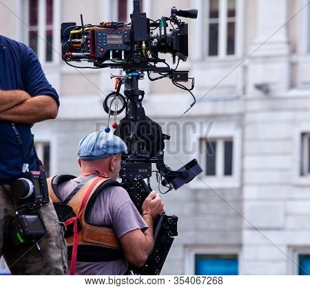 Steady Camera Operator Filming Movie Scene On Outdoor Location