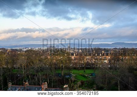 Top Panoramic View On Dean Village In Old Part Of Edinburgh City On Rainy Day, Capital Of Scotland