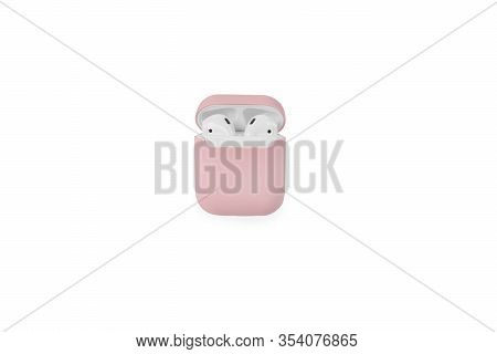 Wireless White Headphones In A Pink Case On A White Background.a Charging Case For Headphones In A P