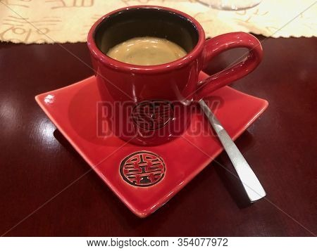 Red Espresso Cup And Saucer With Black Chinese Symbol For Good Luck And Fortune, Coffee Inside. Conc