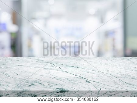 Woden Desk And Blur Abstract Light Background