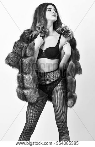 Elite Lingerie For Sensual Girl. Woman Tousled Hairstyle Posing In Black Lingerie And Fur Jacket. Li