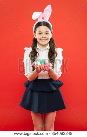 Easter Eggs And Cute Bunny. Child Wearing Bunny Ears On Easter Day. Funny Decoration. Little Girl In