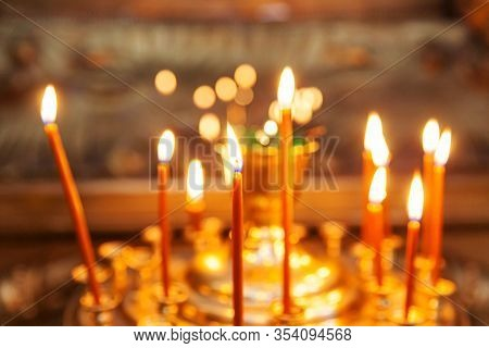 Orthodox Church. Christianity. Festive Interior Decoration With Burning Candles In Traditional Ortho