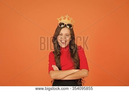 Keep Celebrating. Happy Girl Enjoy Celebrating Orange Background. Little Child Wear Prop Crowm And G