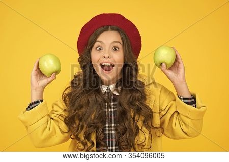 Impressing Harvest. Girl Cute Long Curly Hair Hold Apples. Child Girl Emotional Smiling Face Express
