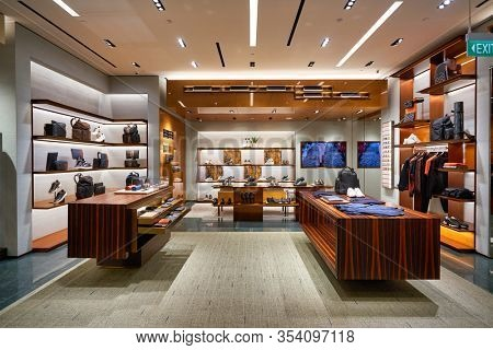 SINGAPORE - JANUARY 20, 2020: interior shot of Ermenegildo Zegna store in the Shoppes at Marina Bay Sands. Ermenegildo Zegna is an Italian luxury fashion house.