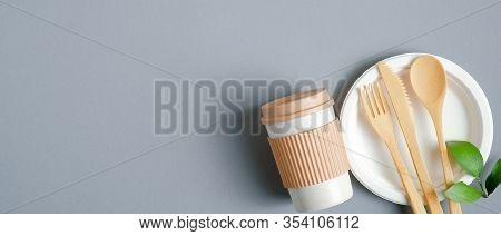 Eco Friendly Bamboo Cutlery And Reusable Coffee Cup On Grey Background. Zero Waste Flatware Concept.