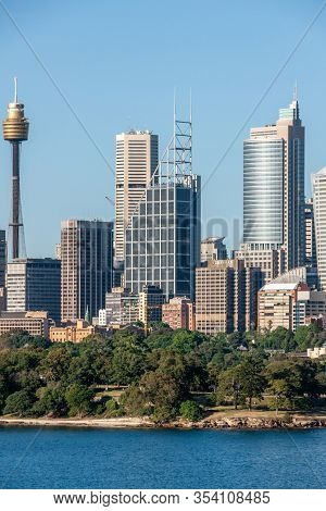 Sydney, Australia - December 11, 2009: Portrait Skyline With Multiple Office Towers Behind Green Bot