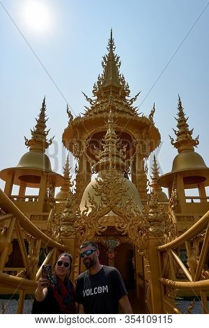 Chiang Rai, Thailand - February.10.2020: People Take Selfie At Golden Building In White Temple Rong