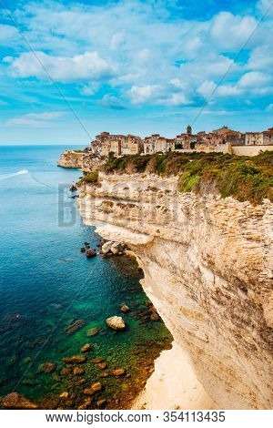 a view of the picturesque Ville Haute, the old town of Bonifacio, in Corse, France, on the top of a cliff over the Mediterranean sea