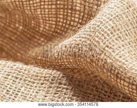 Brown Burlap Textile. Crumpled Sackcloth, Close Up View. Texture Of Burlap Fabric. Brown Baline, Abs