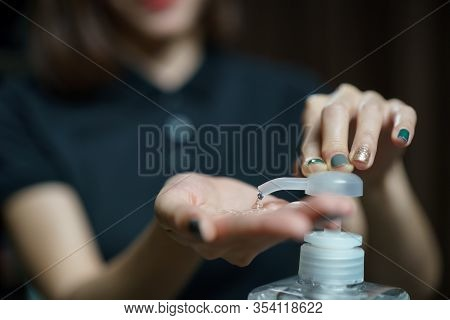 Hands Using Wash Hand Sanitizer Gel Pump Dispenser. Clear Sanitizer In Pump Bottle, For Killing Germ