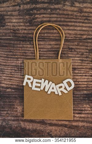 Customer Rewards And Fidelization Incentives Conceptual Still-life, Shopping Bag With Price Tag With