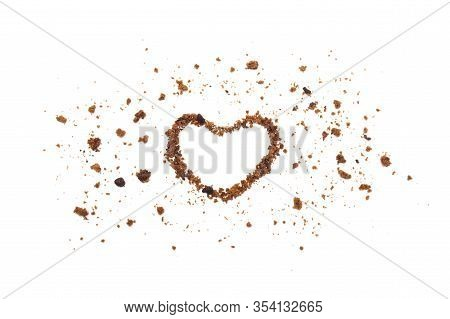 The Shape Of A Heart Line With Crumbs From Chocolate Chip Cookies Isolated On White Background.