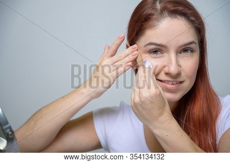 Portrait Beautiful Red-haired Woman With Kinesiology Facelift Tape. Girl Beautician Puts On Face Kin