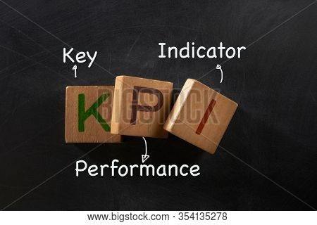Hand drawn Key Performance Indicator (kpi) concept, business strategy on blackboard..