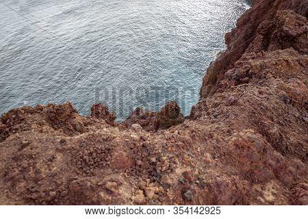 Top View On The Steep Precipice On Rocky Coast