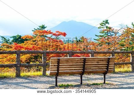A Wood Bench Or Chair On Beautiful Mountain And Colorful Autumn View Background, Iwa-ki-san (stone-a