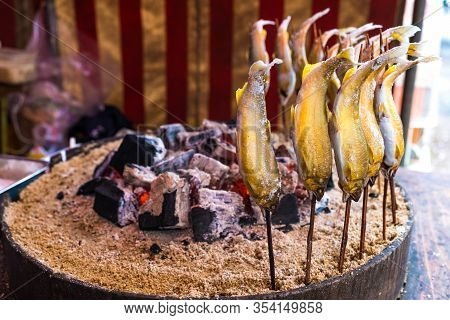 Fish Ayu With Salt Being Charcoal Broiled In Japanese Grilled Style , Ayu  Is Famous Fish And Tradit
