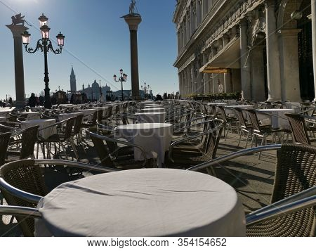 Venice, February 2020. Empty Tables In Front Of A Cafe At San Marco In Venice. No People.