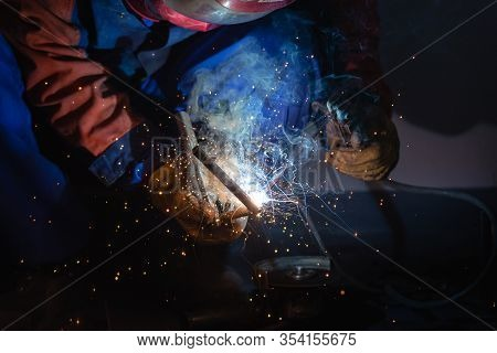 Man Welder At Work. Man Welding Iron At Work. Welder Working With Iron. Man Welder At Work. Welder.