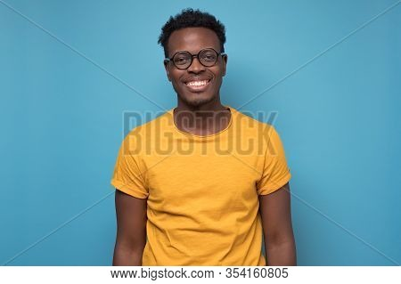 Black African American Young Man In Yellow T-shirt With Cheerful Attitude