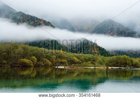 Lake Taisho ,hotaka Mountain Range With Misty In Morning Time, Water Reflection. The Lake Is Located