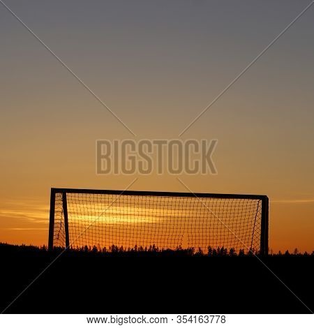 Old Football (soccer) Goal In Silhouette In Sunset