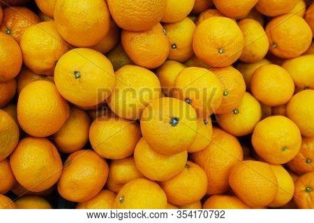 Healthy Fruits, Mandarin Fruits Background. Orange Fruit Background. Mandarin Fruits At Market Store