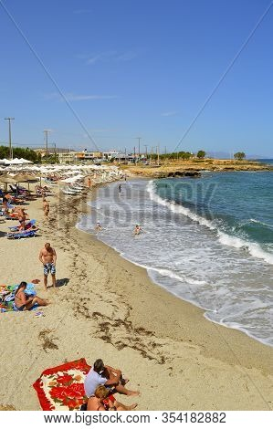 Kato Gouves, Crete, Greece - June 2, 2019 : Tourists On Kato Gouves Beach In Crete The Largest And M